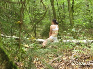 Voyeur POV: Young woman humping a fallen tree in the woods