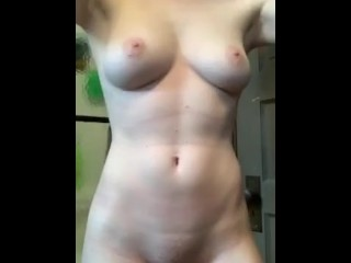 Sexy redhead with perfect body strips
