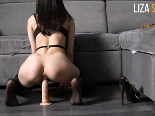 Lustful girl rides a dildo and moans sexually.